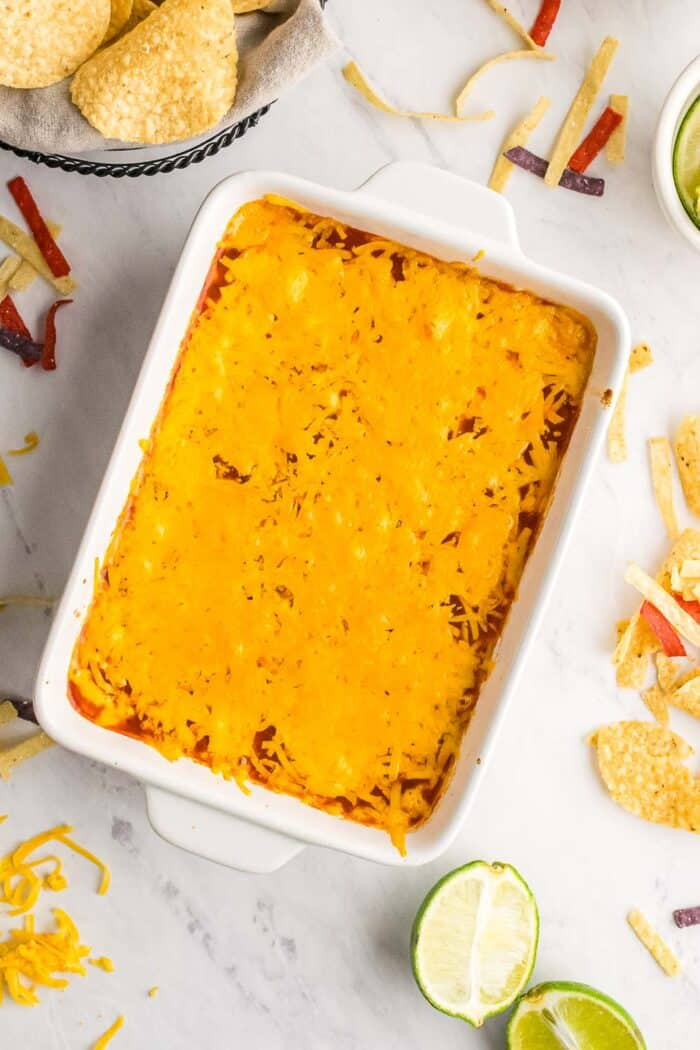 layered hot salsa and cheese dip in a casserole dish