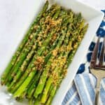 Air Fryer Asparagus with Parmesan on a white rectangle plate