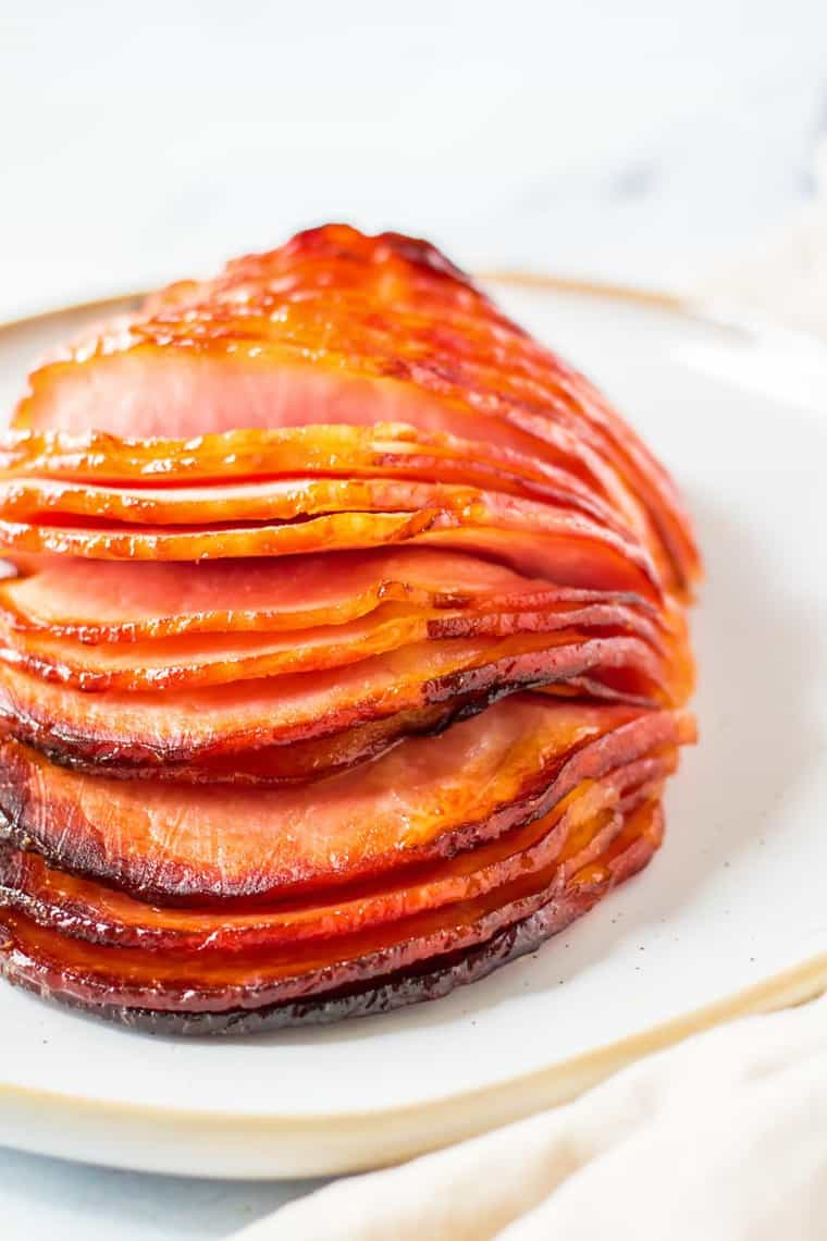 sliced cooked hame with maple glaze