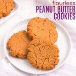 three peanut butter cookies on a white plate