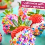 Strawberries that have been dipped in white chocolate and rainbow sprinkles