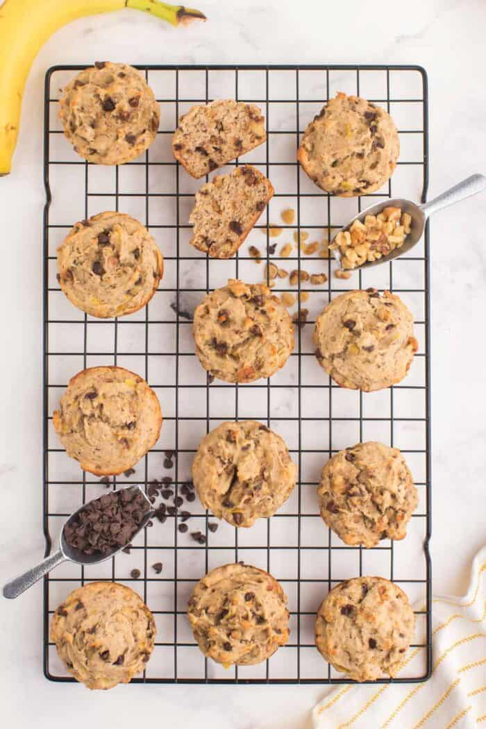 baked gluten free chocolate chip banana muffins on a cooling rack