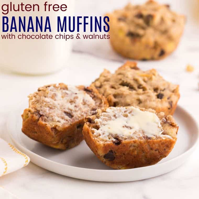 two gluten free banana muffins on a plate, one cut in half and buttered