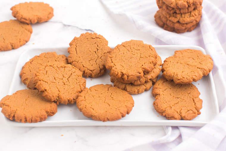 peanut butter cookies scattered on a rectangular platter