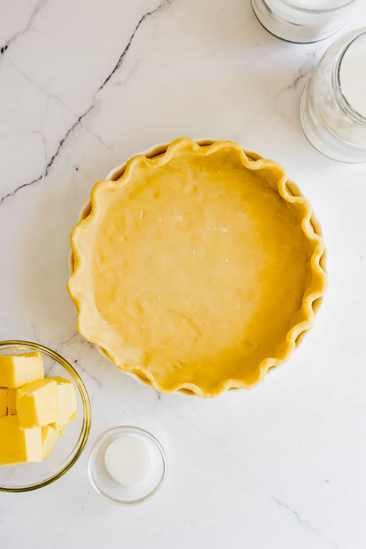 A Pie Crust with Pinched Edges on a Marble Countertop