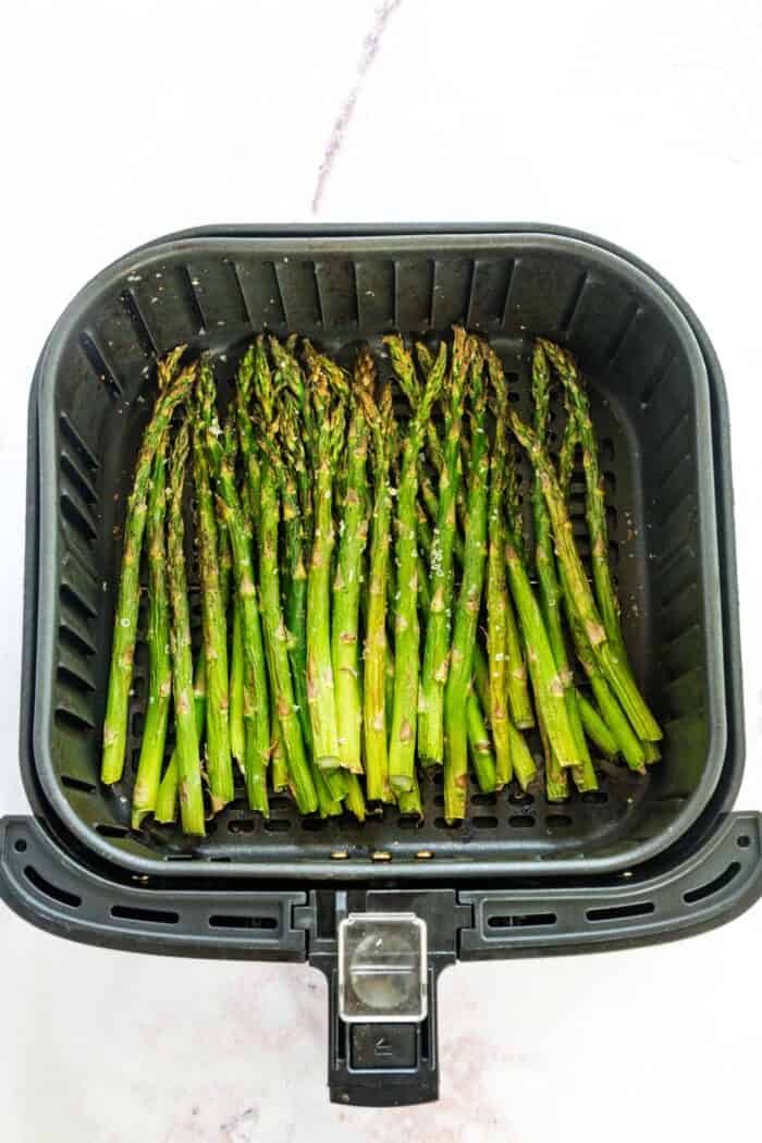 simple roasted asparagus in an air fryer basket