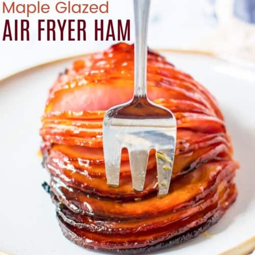 meat fork in slices of glazed ham