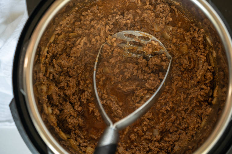 Taco Meat Being Stirred Around in an Instant Pot Bowl