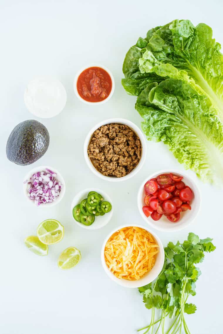 Bowls of Taco Meat, Tomatoes, Cheese and the Other Taco Bowl Ingredients on a Counter