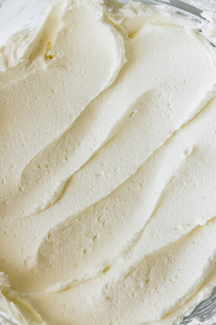 A Close-Up Image of Vanilla Buttercream Frosting in a Mixing Bowl