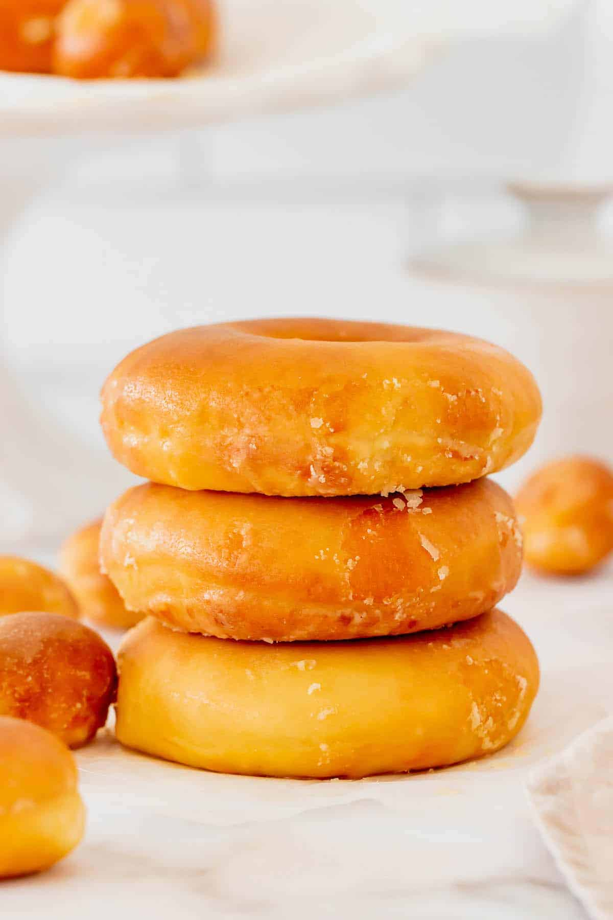A Stack of Three Homemade Donuts with Vanilla Glaze
