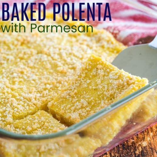 silver serving utensil lifting a piece of baked polenta with parmesan cheese on top
