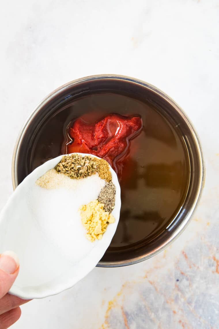 adding spices to a small saucepan