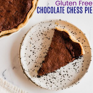 top of a piece of chocolate chess pie on a black and white speckled plate
