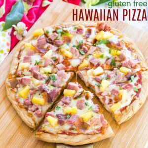 sliced hawaiian pizza on a cutting board