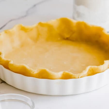 pie dough pressed into a white pie plate