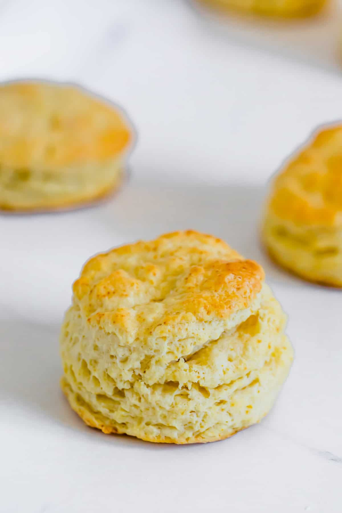 A Golden Gluten-Free Sweet Biscuit on a White Marble Countertop