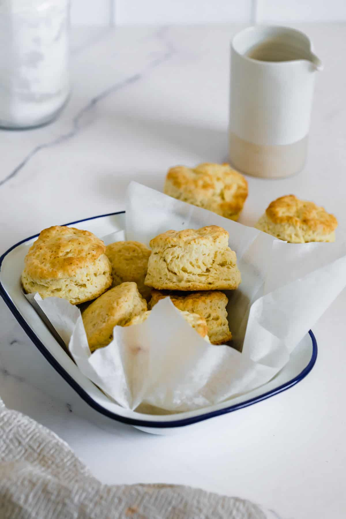 A Bowl Lined with Parchment Paper Containing Homemade Gluten-Free Biscuits