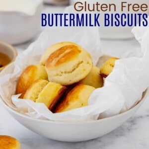 gluten free biscuits piled in a wax paper-lined bowl