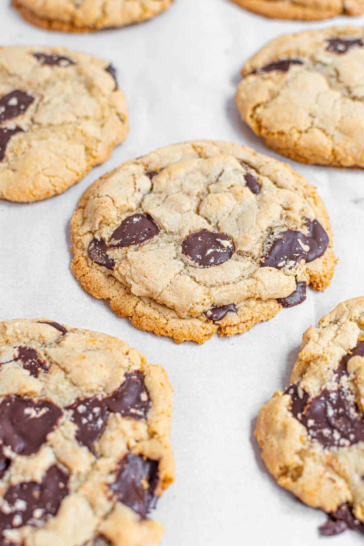 A Close-Up Shot of Gluten Free Chocolate Chip Cookies on a Parchment-Lined Baking Sheet