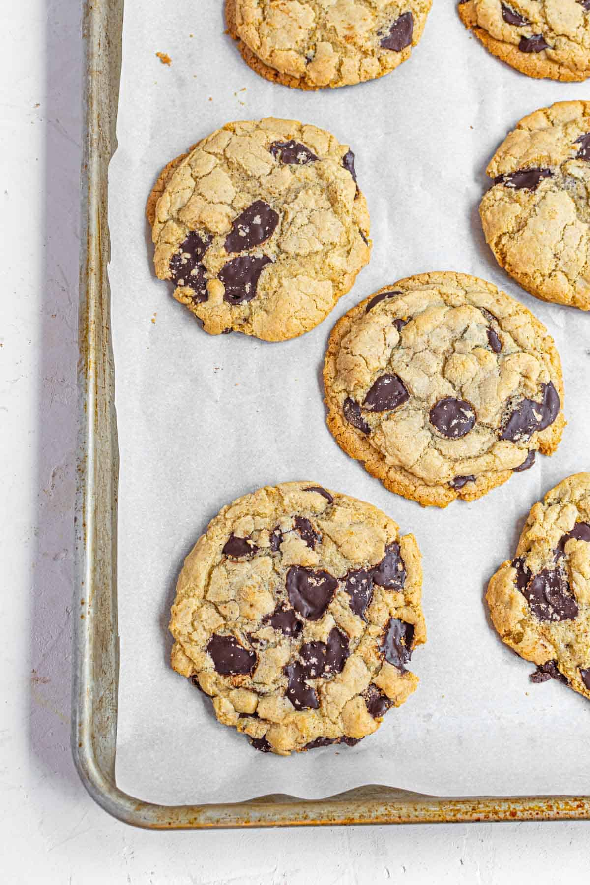 Chocolate Chip Cookies Arranged on a Pan Lined with Parchment Paper