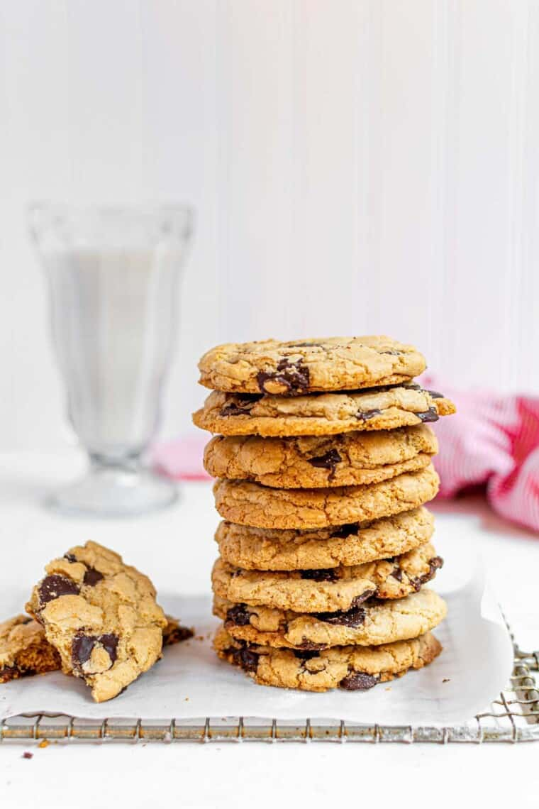 stack of chocolate chip cookies and one broken in half next to it