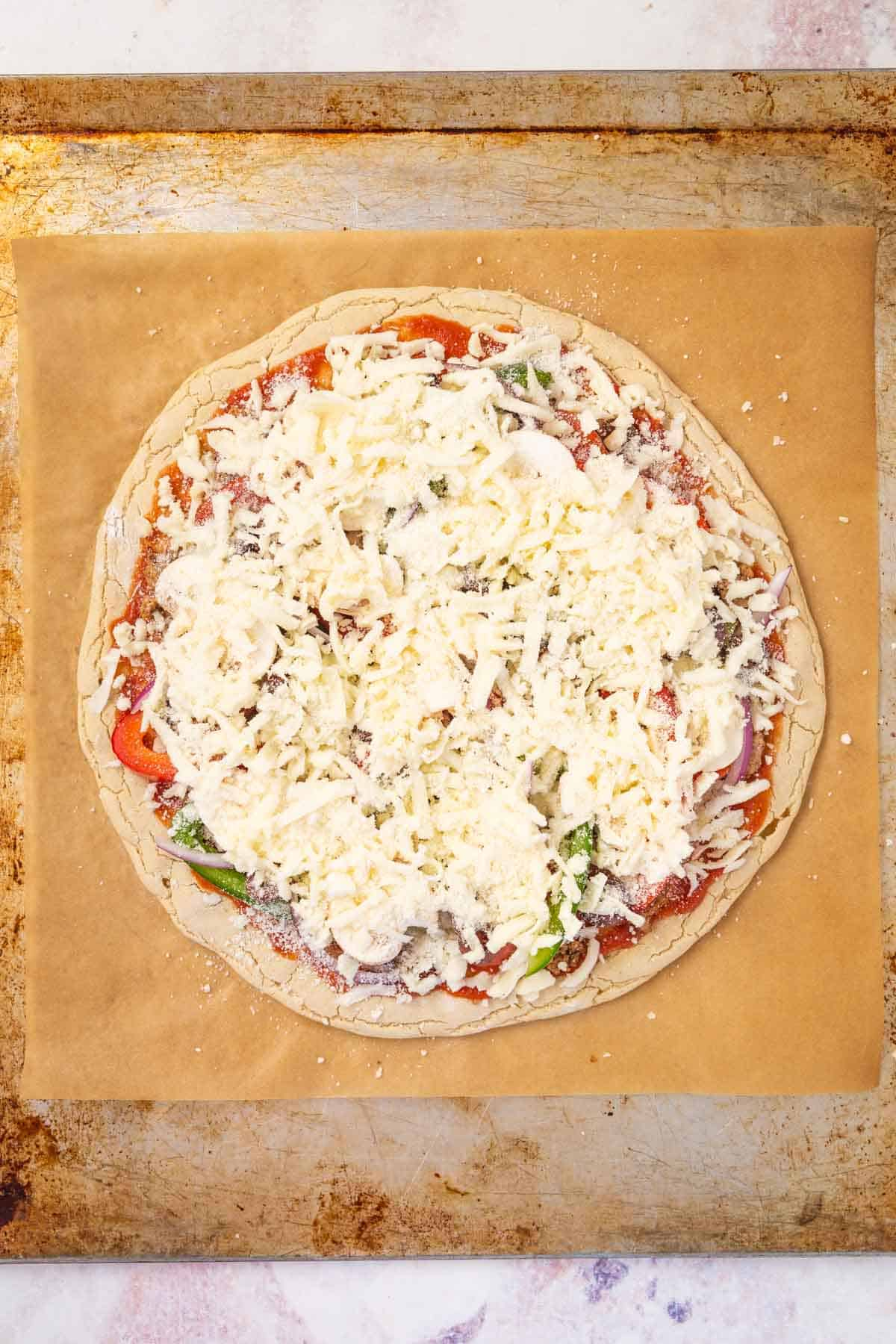 The Cheese on Top of the Veggies, Meat, Sauce and Crust of a Supreme Pizza