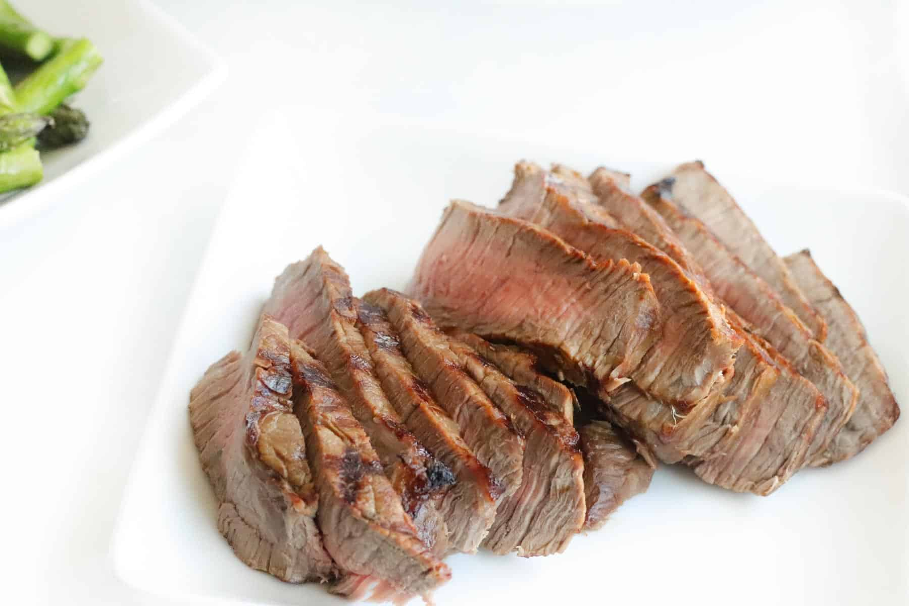 sliced gilled steak on a plate