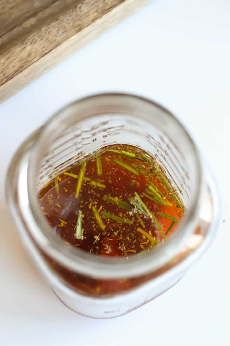 looking into the top of a jar with the vinaigrette ingredients