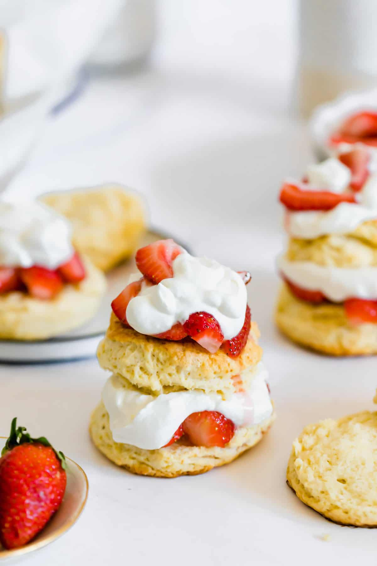 Strawberry Shortcakes with Homemade Whipped Cream on a White Countertop