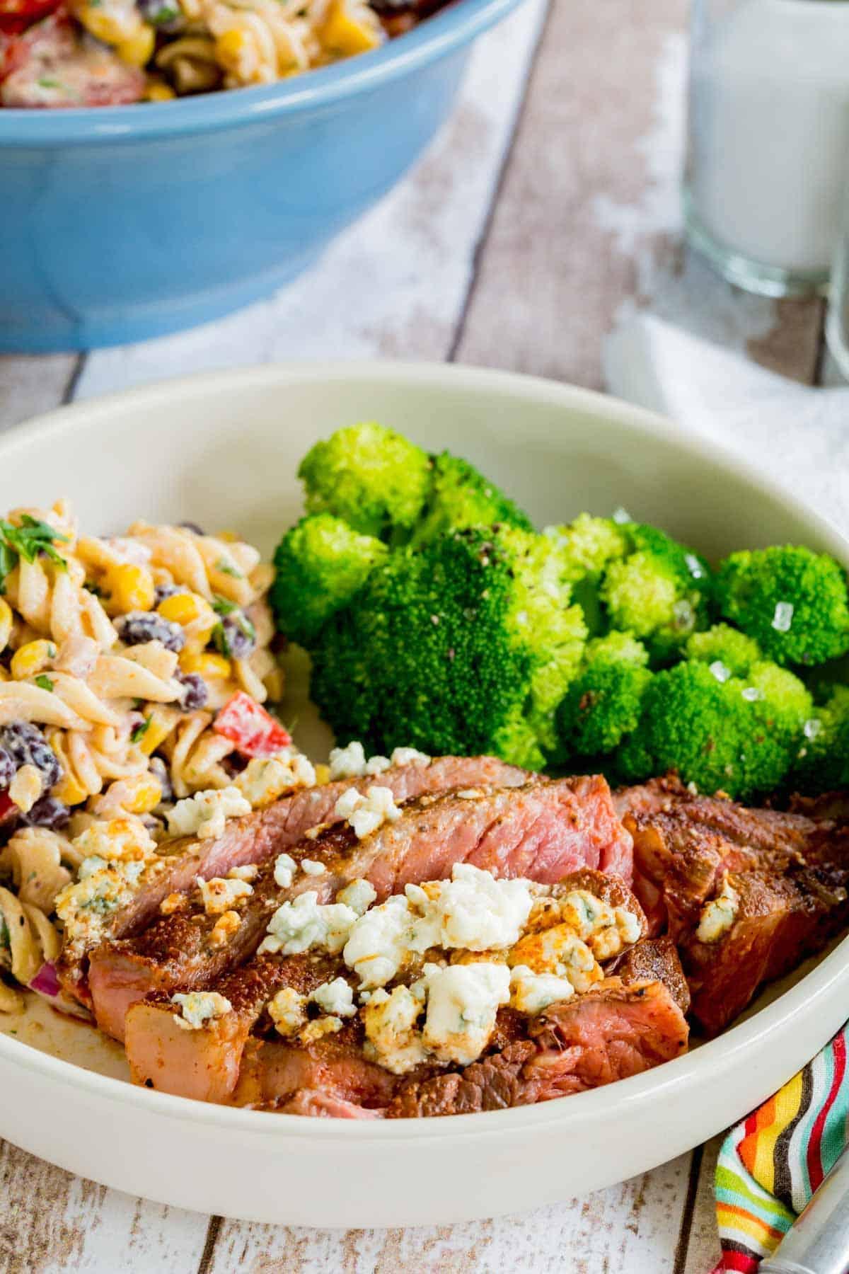 A Plate of Black and Blue Steak, Broccoli and Macaroni Salad
