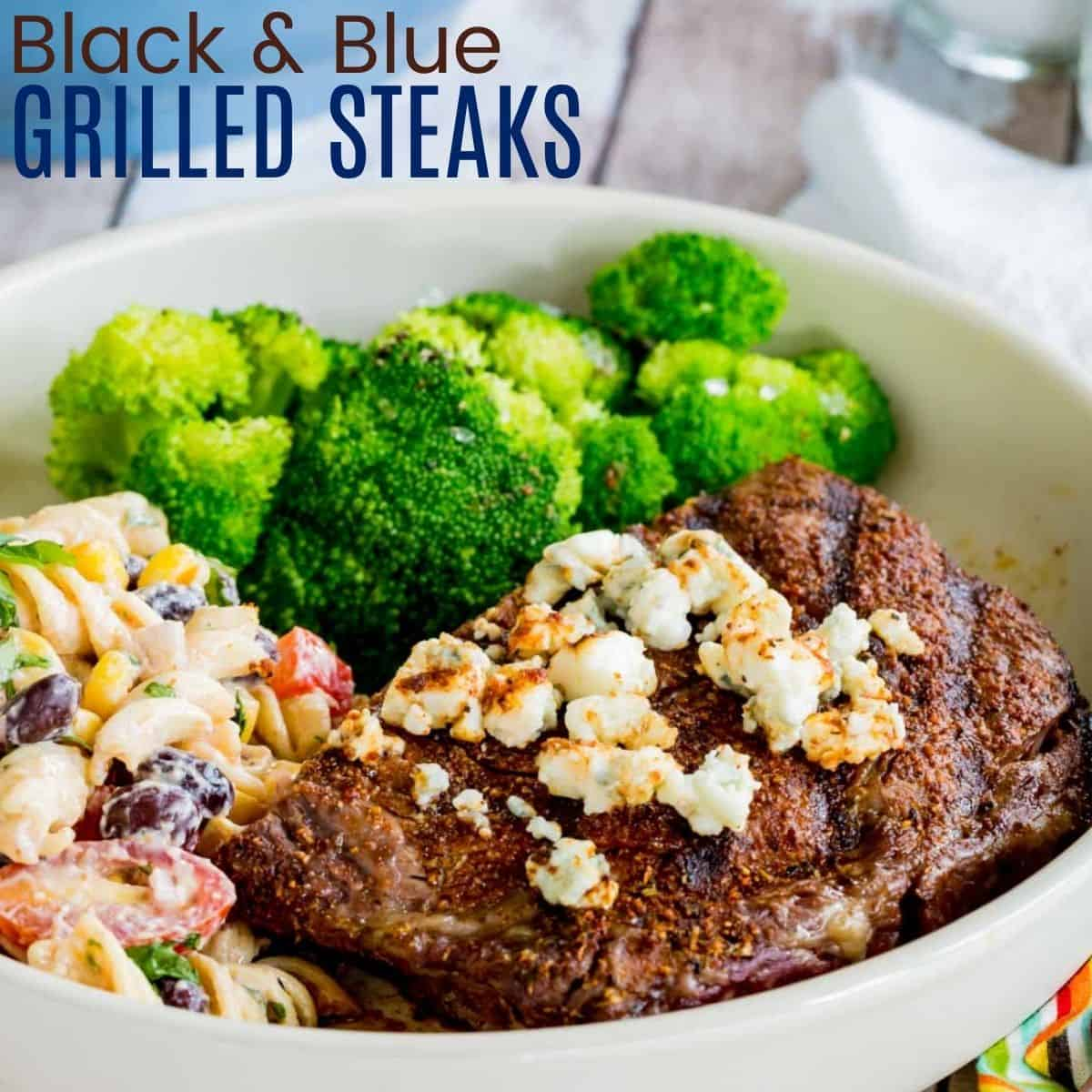 steak topped with blue cheese on a plate with potato salad and steamed broccoli
