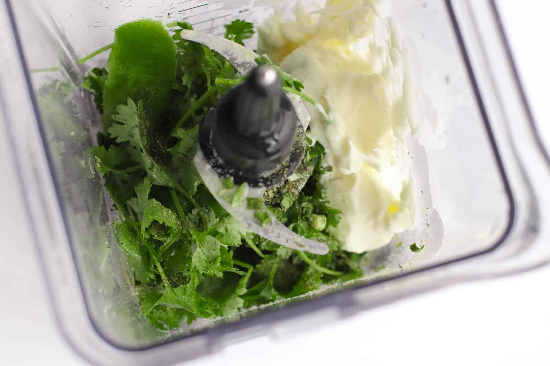 cilantro, mayonnaise, and other dressing ingredients in a blender