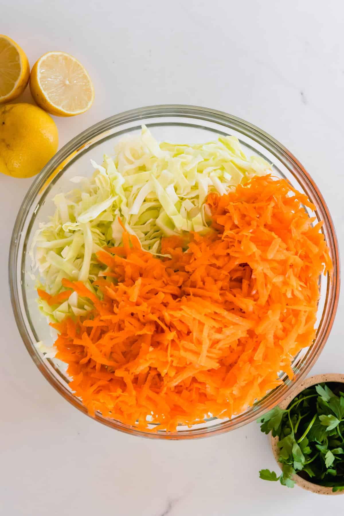 Shredded Carrots and Cabbage in a Big Glass Mixing Bowl