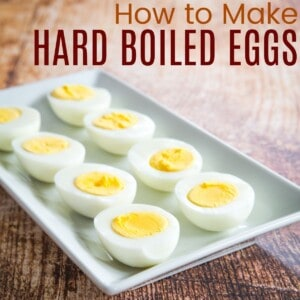 four hard boiled eggs cut in half on a white plate