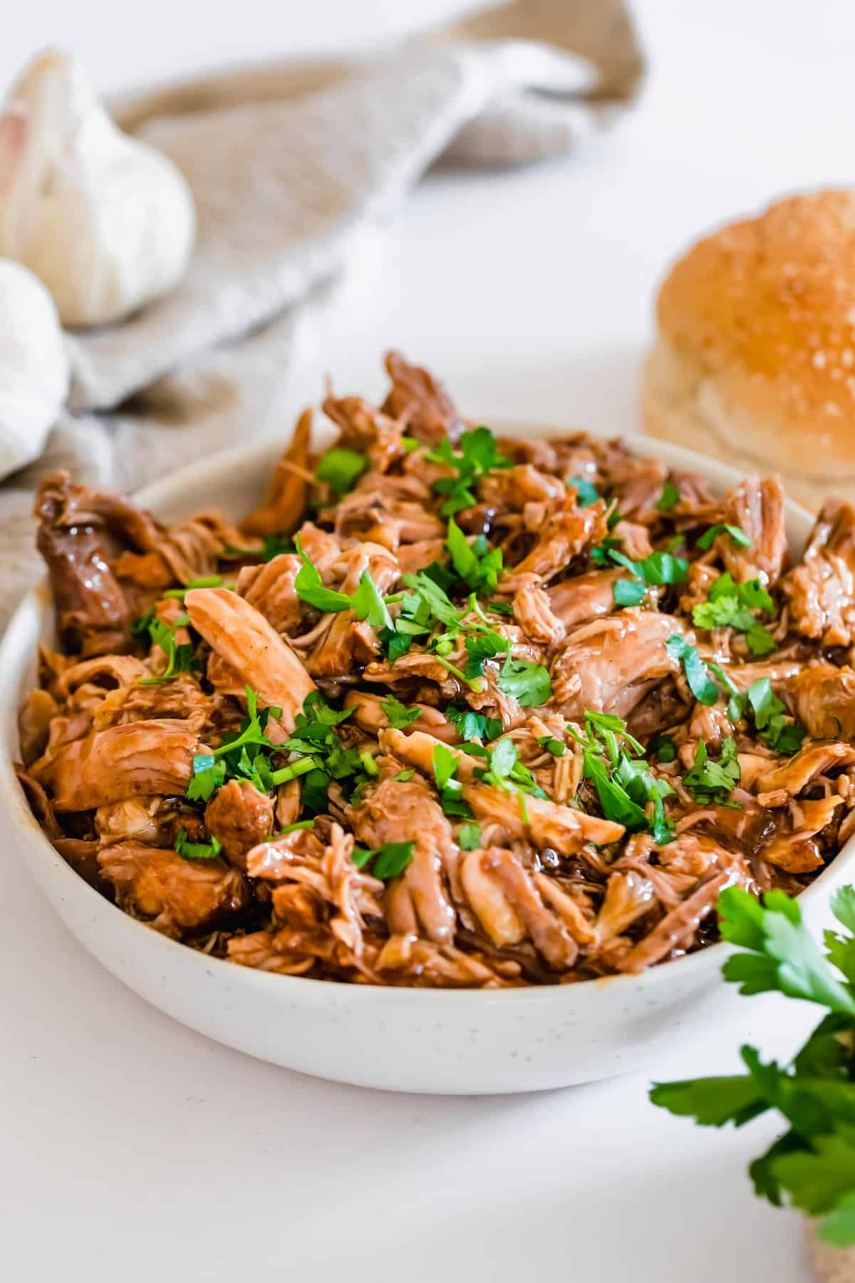 A Bowl of Instant Pot Pulled Pork Garnished with Chopped Parsley