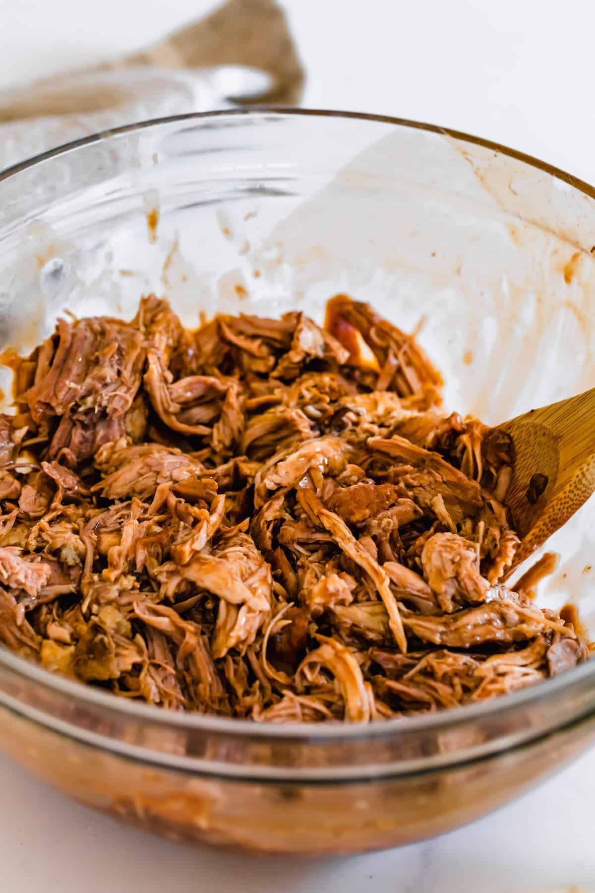Instant Pot BBQ Pulled Pork Inside of a Large Glass Mixing Bowl