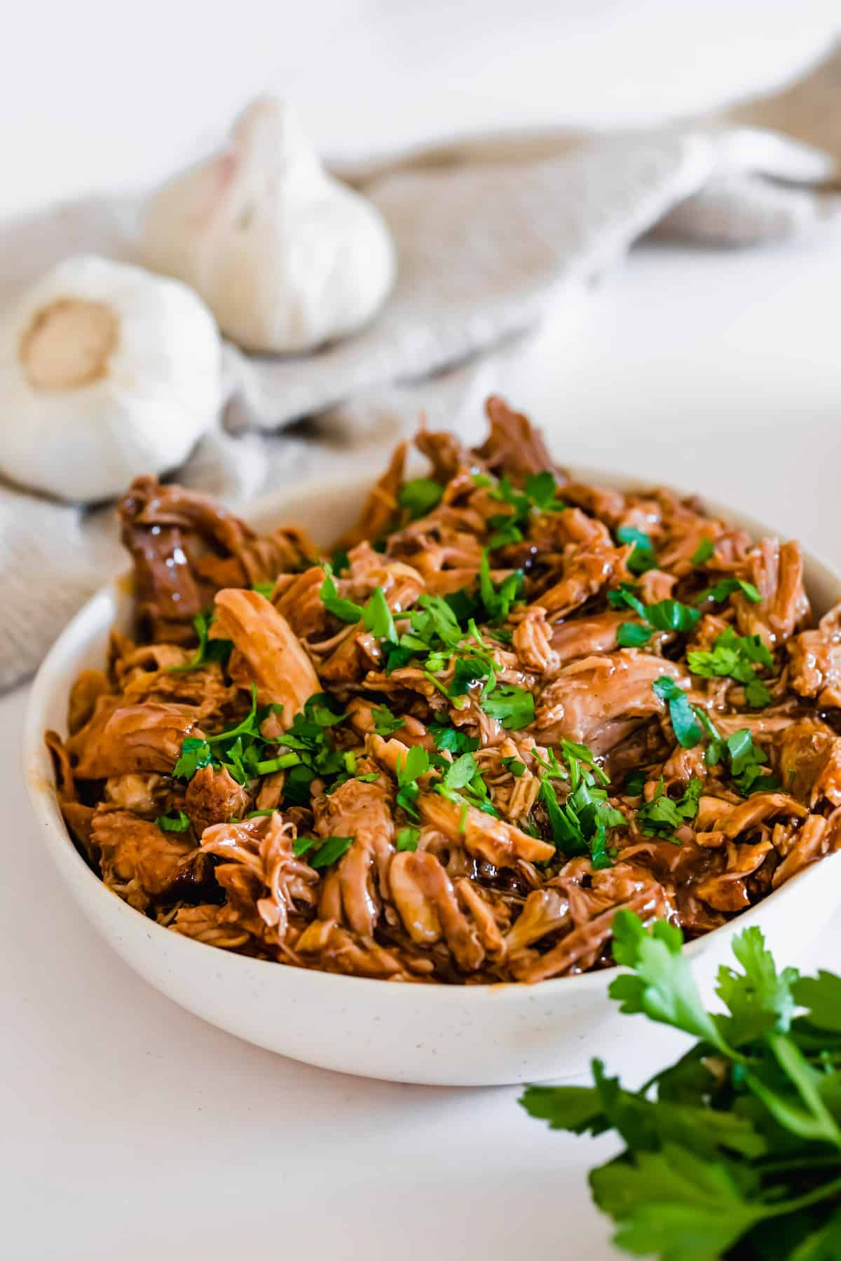 Instant Pot Pulled Pork in a White Bowl on a White Countertop