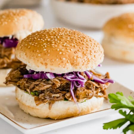 barbecue pulled pork sandwiches on sesame seed rolls
