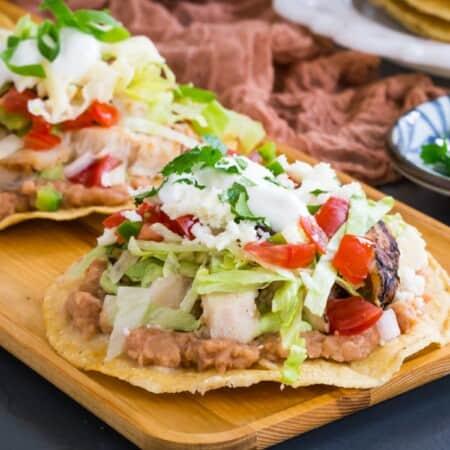 chicken tostadas on a serving platter