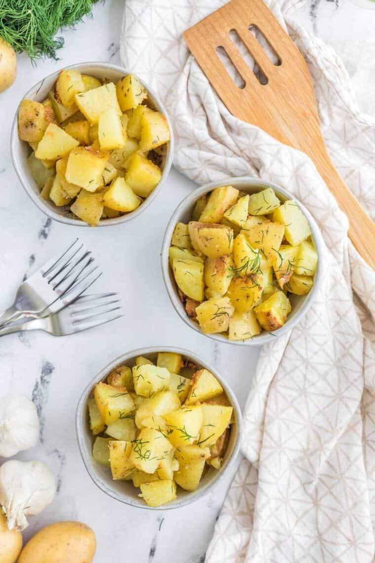 three bowls of dill hash brown potatoes