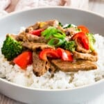 pale blue bowl of white rice topped with hunan beef