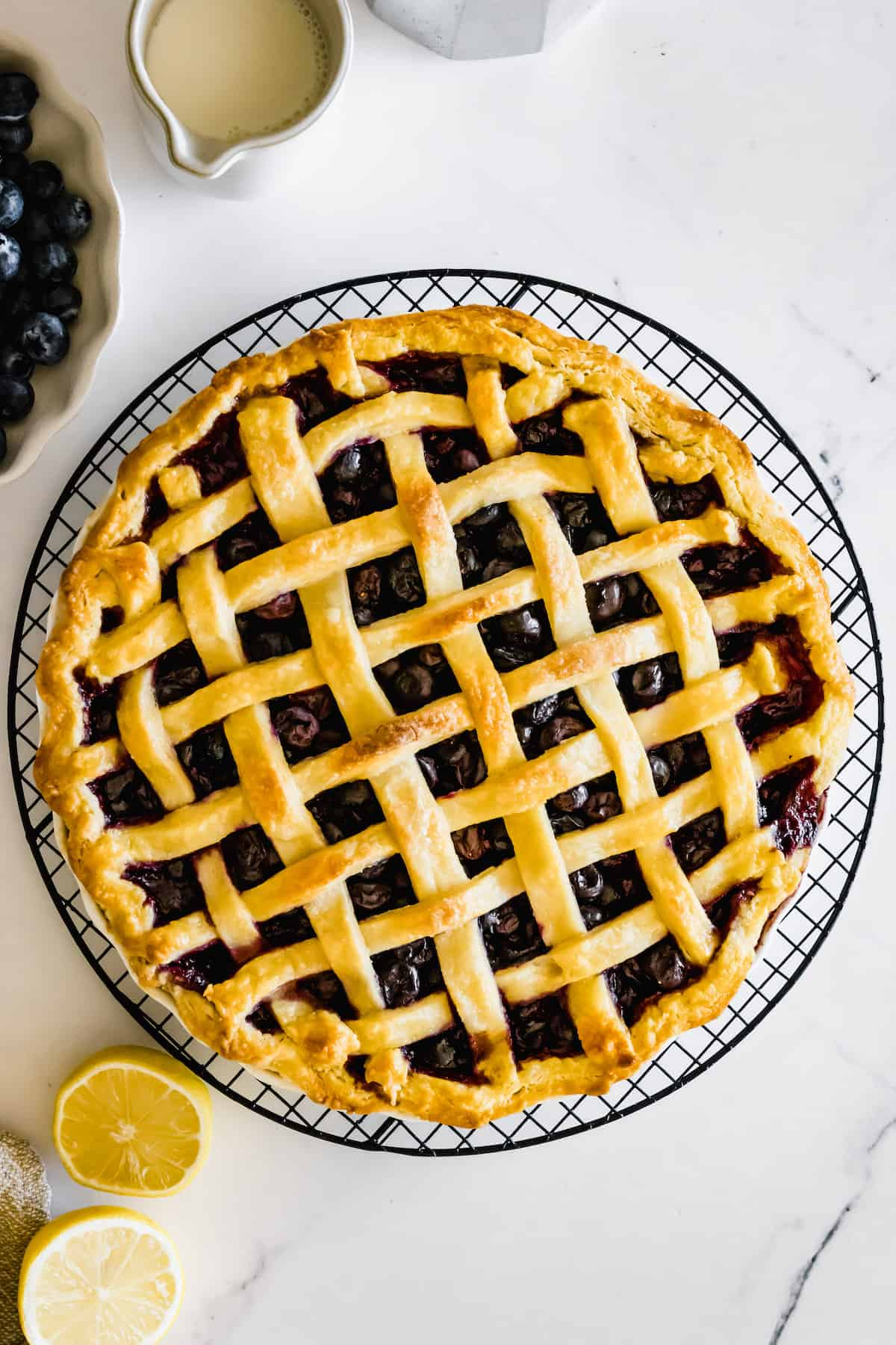 A Freshly Baked Blueberry Pie on a Circular Cooling Rack