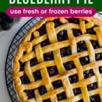lattice-topped blueberry pie on a cooling rack