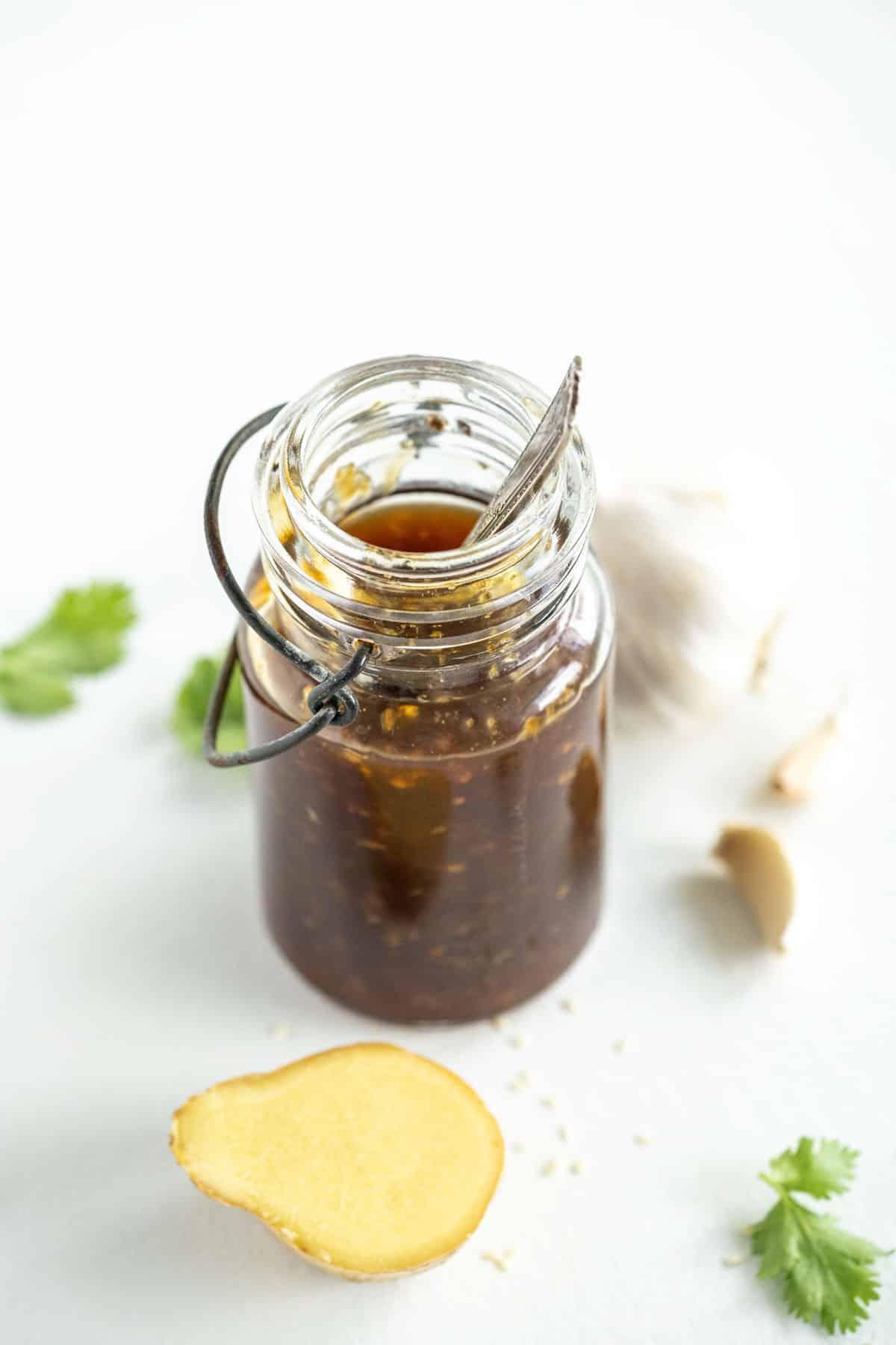 jar of gluten-free teriyaki sauce with fresh ginger, herbs and garlic