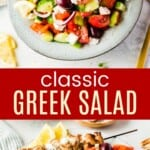 spoon picking up greek salad from a serving bowl and some of it in a plate with chicken kabobs and pita