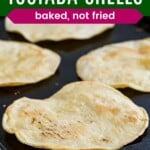 baked tostada shells on a baking sheet
