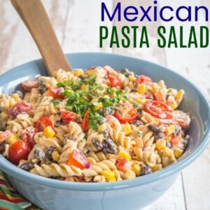 serving bowl of mexican pasta salad on top of a striped napkin