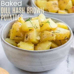 a bowl of roasted potatoes chunks with dill