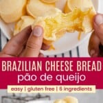 a person's hands breaking open a pao de queijo over a plate full of them and more of the Brazilian cheese bread in a bowl
